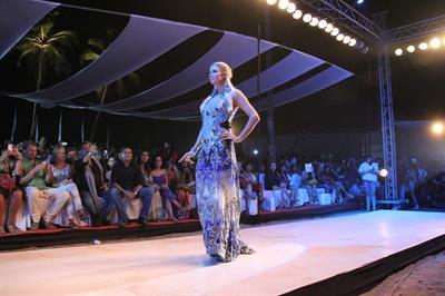 Paris Hilton walks for designer duo Shane and Falguni Peacock and performs as a DJ at the India Resort Fashion Week