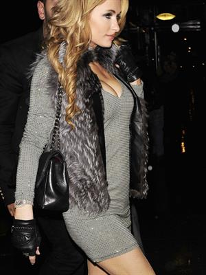 Paris Hilton going out with a wet spot on December 16, 2014