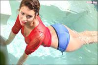 Holly Peers in a USA bikini getting topless in the pool