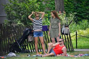 Heidi Klum in a black and white striped shirt, spends a day out in a park in Tribeca on June 30, 2013