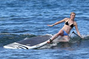 Ireland Baldwin goes paddle-boarding in Hawaii with her boyfriend Slater Trout May 26, 2013