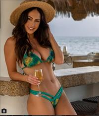 Hope Beel in a bikini taking a selfie