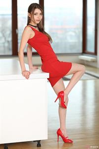 Mila Azul takes off her red dress