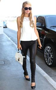 Paris Hilton Arrives at LAAirport in Los Angeles (September 6, 2013)