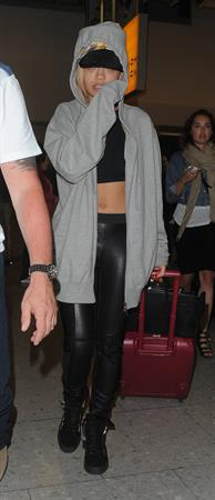 Rita Ora catches a flight at Heathrow Airport in London (27.06.2013)