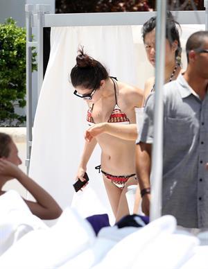 Selena Gomez in bikini by a hotel pool in Miami 5/11/13