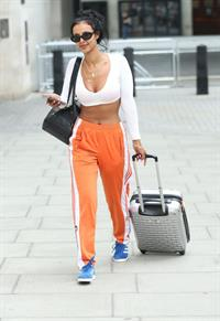 Maya Jama sexy in a crop top showing some nice cleavage seen by paparazzi.