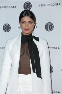 Priyanka Chopra braless boobs in a see through top showing some nice cleavage at Beautycon.