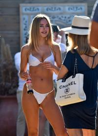 Kimberley Garner sexy ass and boobs in a little white bikini showing nice cleavage seen by paparazzi.