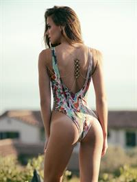 Dessie Mitcheson in a sexy and funky print, one piece swimsuit
