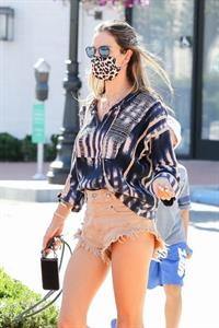 Alessandra Ambrosio upskirt wardrobe malfunction flashing her panties wearing cut off shorts seen by paparazzi.