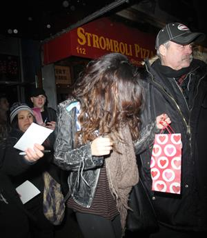 Selena Gomez surrounded by fans for autographs in New York City on February 5, 2013