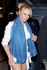 Pamela Anderson shows some legs at Los Angeles International Airport on February 20, 2013
